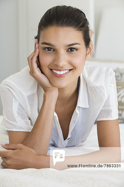 Portrait of a woman smiling on the bed