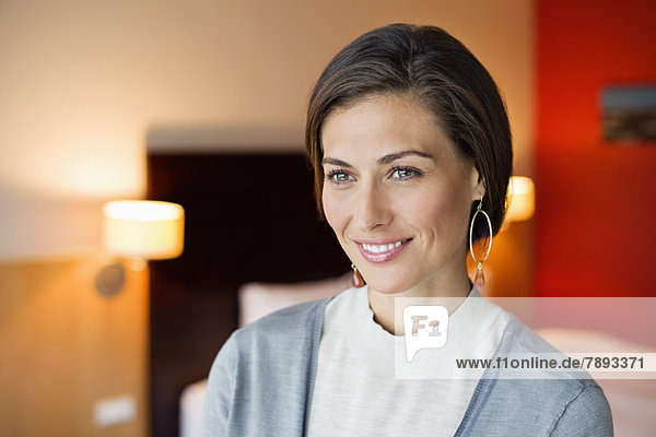 Woman smiling in a hotel room