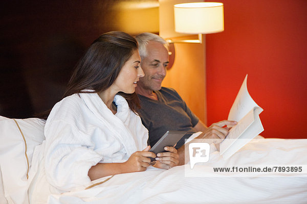 Couple reading a book in a hotel room