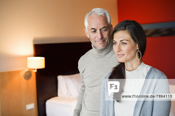 Couple smiling in a hotel room