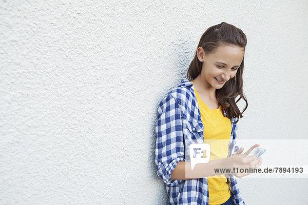 Happy girl looking at pocket money