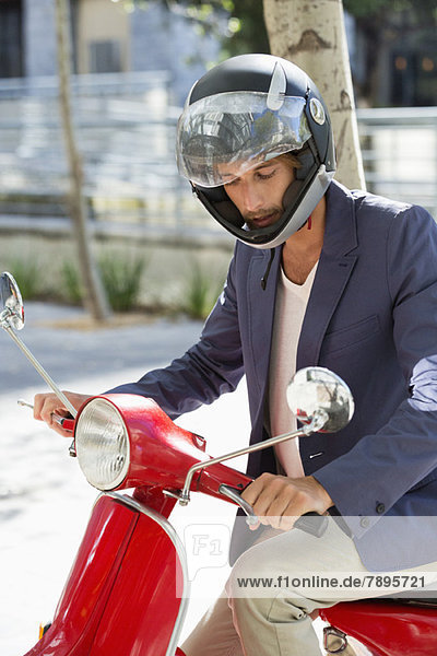 Man riding a scooter