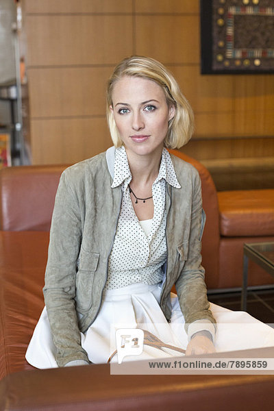 Portrait of a woman sitting at an airport lounge