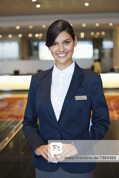 Portrait of a receptionist smiling in a hotel lobby