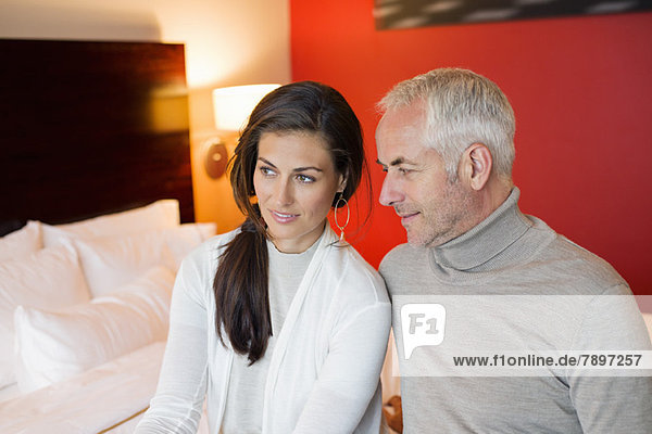 Couple sitting together in a hotel room