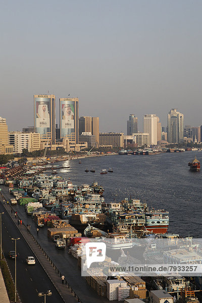 Views over Dubai Creek with traditional wooden boats known as dhow