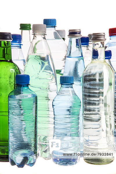 Different varieties of mineral water in bottles made of glass and plastic or PET