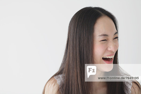 Young woman with long hair laughing