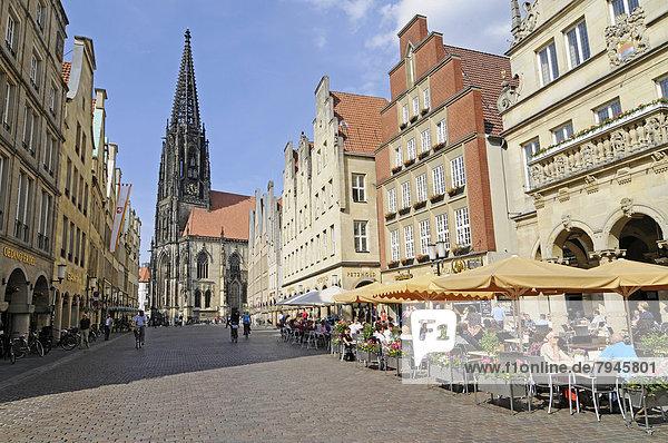St. Lamberti Church  St Lambert's Church  Prinzipalmarkt street  gabled houses  outdoor cafés
