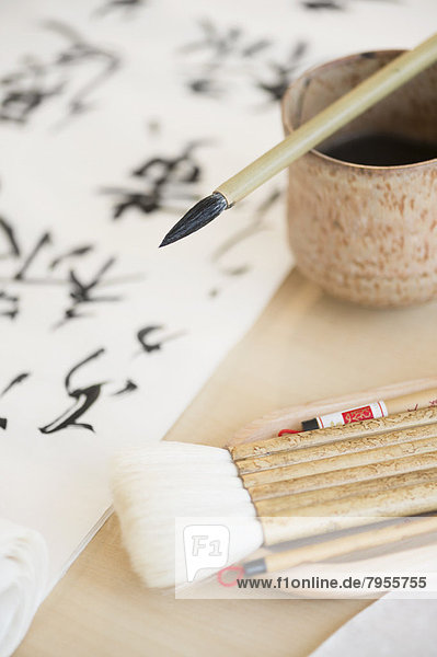 Calligraphy paintbrushes  ink and Japanese script