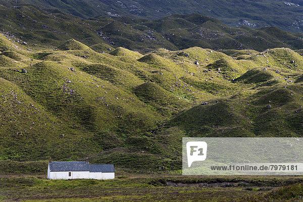 United Kingdom,  Scotland,  View of Cottage at Torridon hills