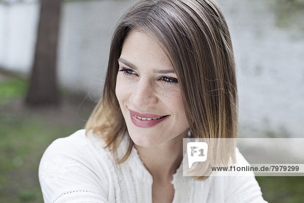 Young woman looking away  smiling