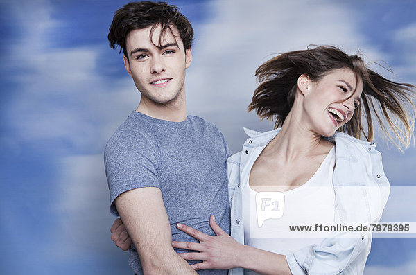 Germany  Cologne  Young couple embracing each other  smiling