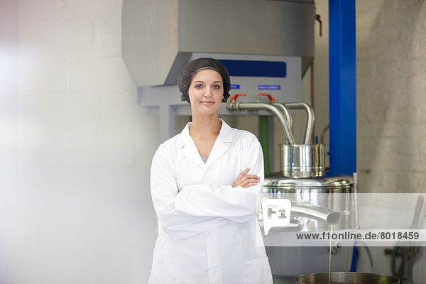 Portrait of woman in olive processing plant