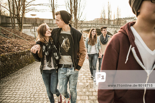 Five teenagers walking together