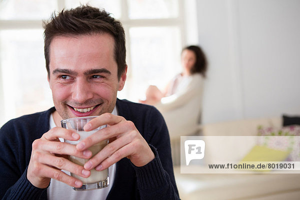 Mature man drinking a smoothie