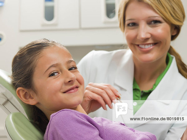 Dentist and young patient smiling  portrait