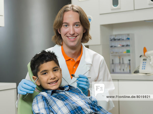 Dentist and young boy smiling  portrait