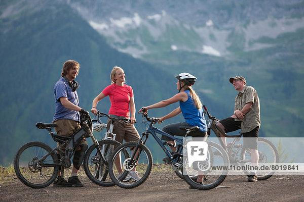 Four friends mountain biking together