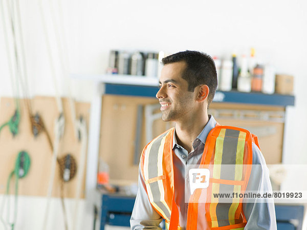Mid adult construction worker smiling