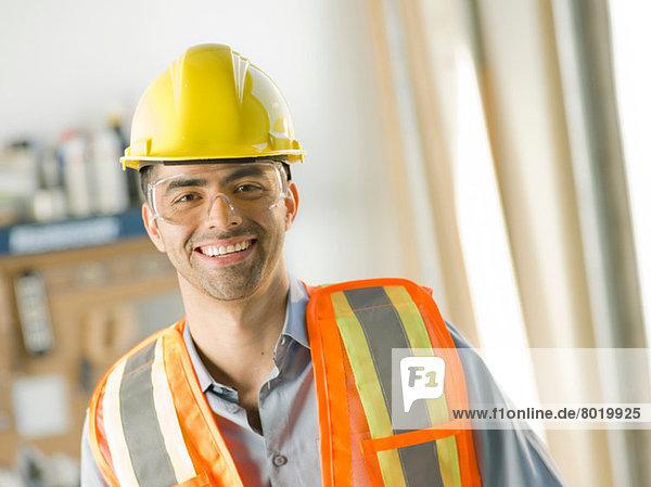 Mid adult construction worker smiling  portrait
