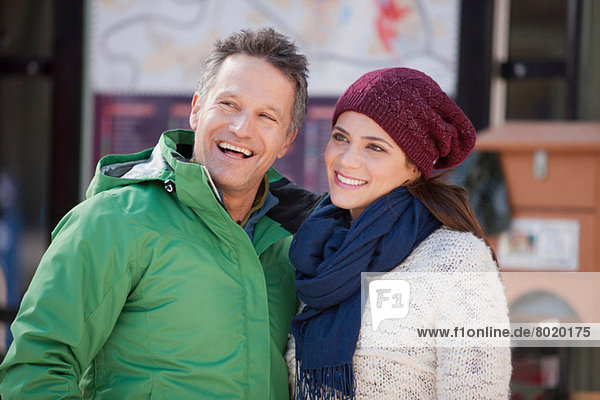 Couple in warm clothing smiling