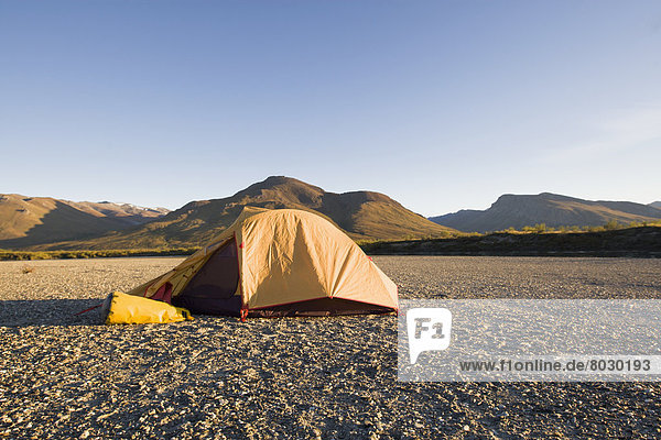 A tent and the mountains of the brooks range gates of the arctic national park northwestern alaska Alaska united states of america