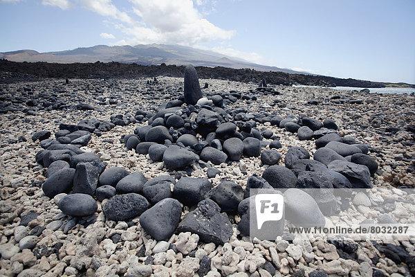 Hawaii  Maui  Kanaio  A rock formation along coast with Haleakala in the background