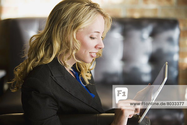 Young Businesswoman Using A Tablet  Bradford Ontario Canada