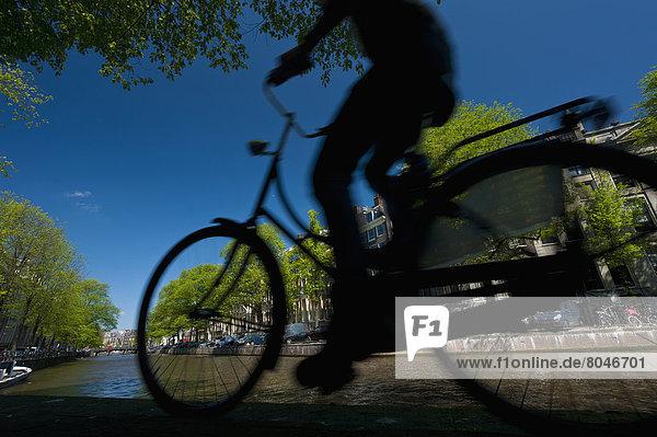 Amsterdam  Hauptstadt  Mann  Silhouette  radfahren  Nostalgie  Niederlande