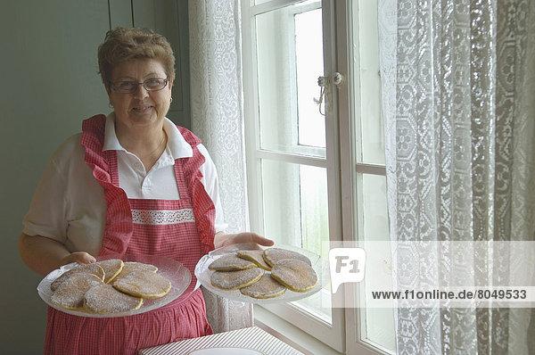 Home made cakes at Alnes lighthouse near Alesund  Godoy Island  Moere og Romsdal  Norway