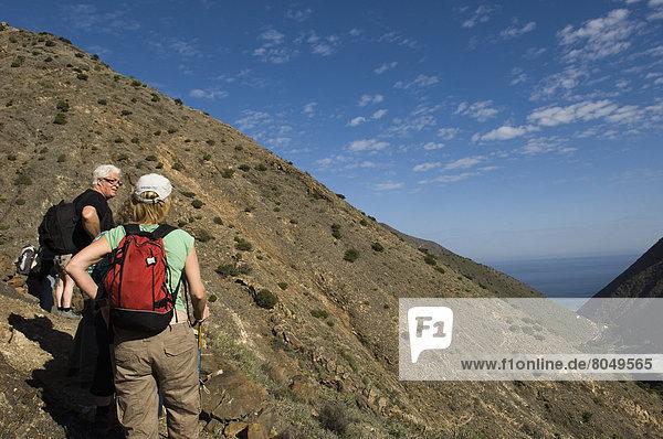 Tourist hiking on Vallehermoso trail,  La Gomera,  Canary Islands,  Spain