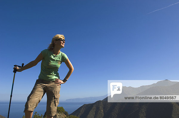 Young woman hiking on Vallehermoso trail  La Gomera  Canary Islands  Spain