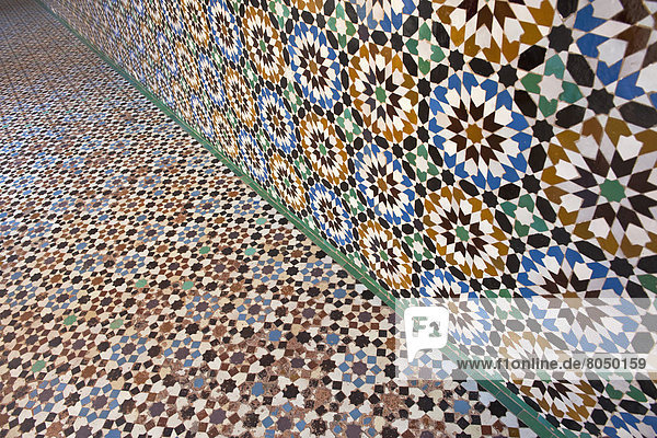 Detail of mosaic wall and floor in Ben Youssef Medersa,  Marrakesh,  Morocco
