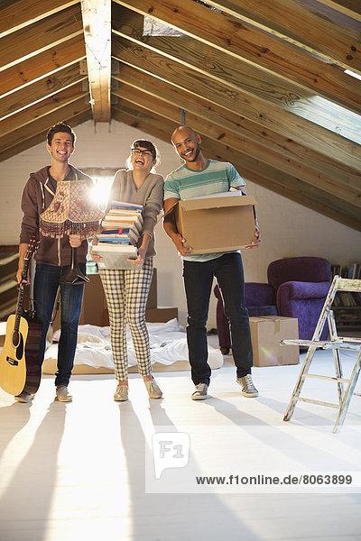Friends putting items in attic