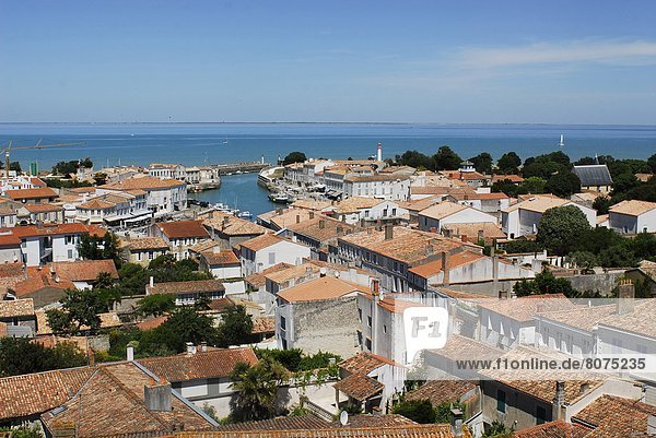 View of the tile roofed houses of Saint-Martin-de-Ré on the Isle of Rhé (17): the village and view of the sea