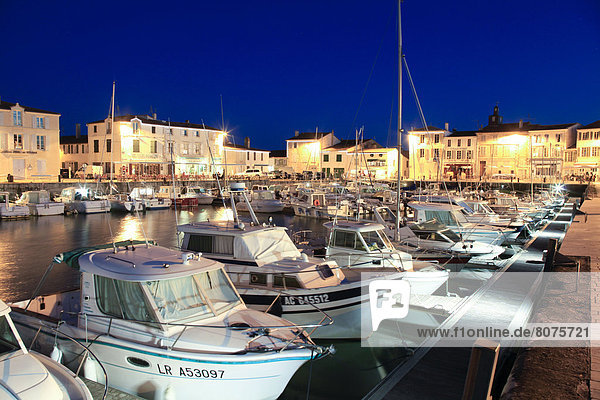 'Night view of the harbour of La Flotte-en-Re  ''ile de Re''  Isle of Rhe  along the Atlantic coast in the Charente-Maritime department (17). View of the village lit up at night (All rights reserved. Only postcard production)'