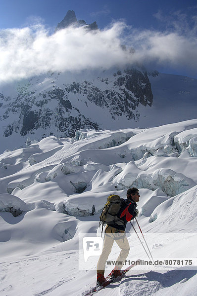 'Chamonix : A group of skiers in the Vallee Blanche (''White Valley'') with mountains in the background'