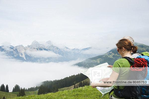Couple hiking  Neunerkoepfle  Allgaeu Alps  Tannheim Valley  Tyrol  Austria  Europe