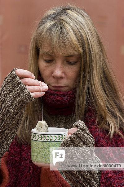 Woman with tea  drinking  illness