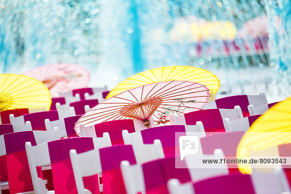 Parasols and silk scarves on chairs outdoors