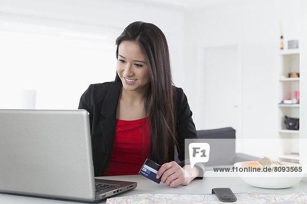 Mixed race businesswoman shopping online