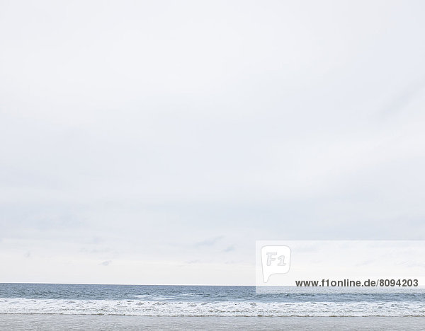 Beach and ocean under overcast sky