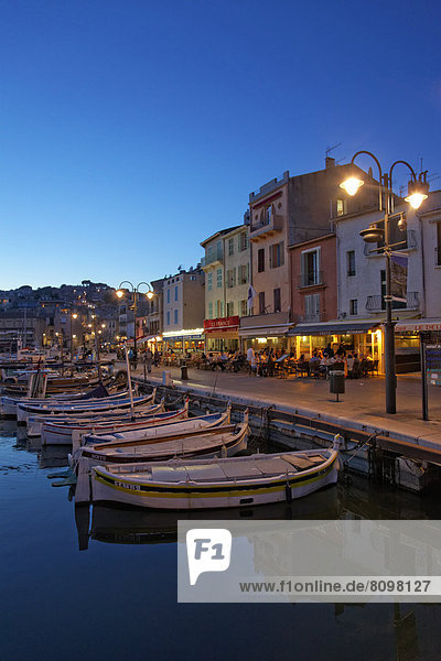 Harbour and historic town centre  small fishing boats  street cafes and restaurants  evening mood