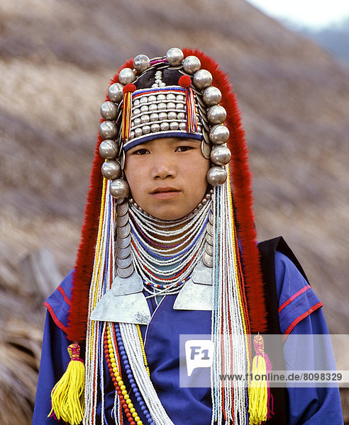 Akha girl with traditional clothing and headdress  portrait