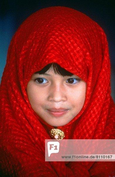 Muslim girl in red hijab  Sabah  Malaysia