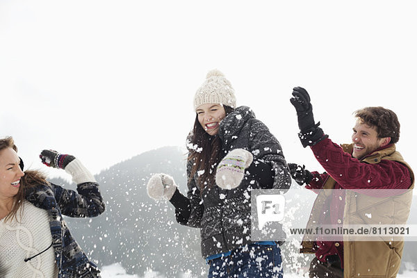 Couple enjoying snowball fight