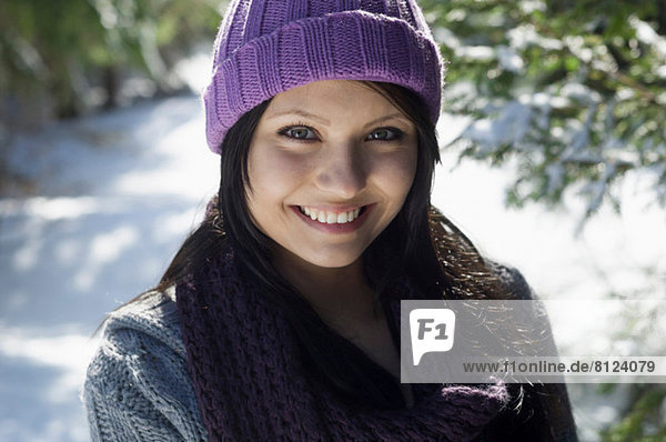 Close up portrait of young female wearing knitted hat