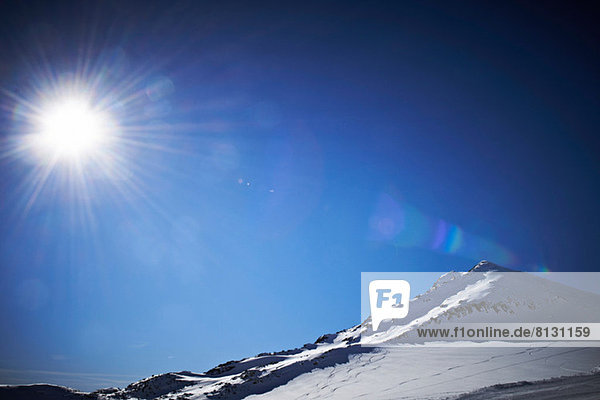 Sunlit  snowcapped mountain in Austria