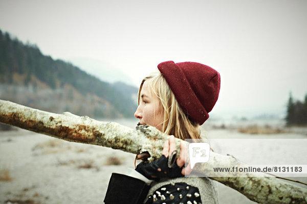 Woman holding log
